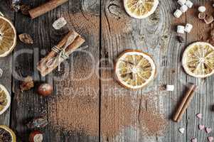 Abstract gray wooden background with spices and dried fruit