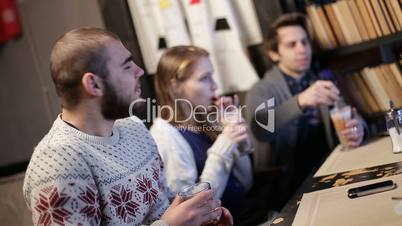 Joyful teenage friends relaxing in coffee shop.