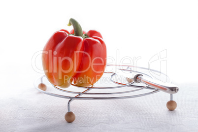 Fresh Vegetarian Food. Red Pepper on a white surface.