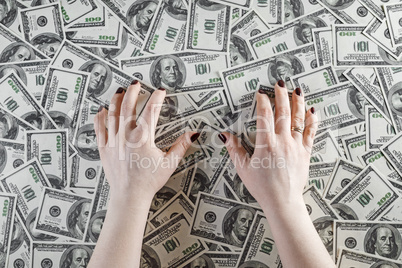 Female hands and money