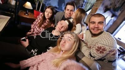Group of friends taking selfie on smart phone