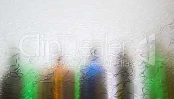 Blurred defocused bottles abstract background.