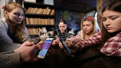 Best friends group surfing net with mobile phones
