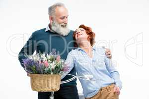 Mature couple with bicycle