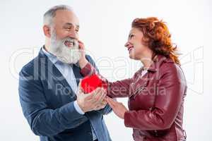 Mature couple with gift box