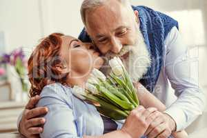 Mature couple with flowers