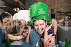 Young friends having fun during celebration of st patricks day