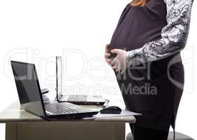 Standing pregnant woman in office