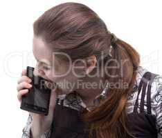 Angry woman biting cracked smartphone