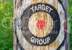 Target Group - tree with target and text in the forest