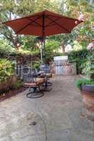 Chair, table, umbrella and feng shui garden decor