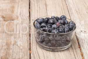Clear glass bowl of ripe blueberries