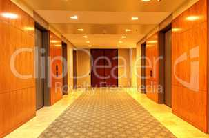 Polished, high end up and down elevator hallway