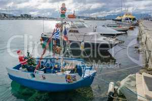 Boat decorated for Christmas in the port of Aegina, Greece.