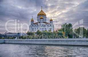 Moscow summer landscape with river and church of Christ Saviour.