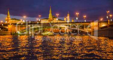 Moscow night landscape with river and kremlin.