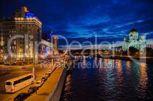 Moscow night landscape with road and river and church of Christ