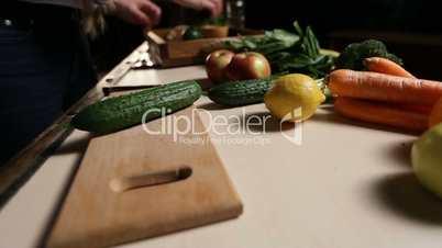Organic fresh cucumber on wooden chopping board.