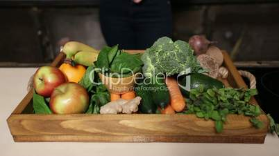 Fresh organic fruits and vegetables in wooden tray
