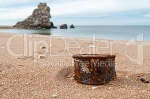 Rusty tin can on the beach