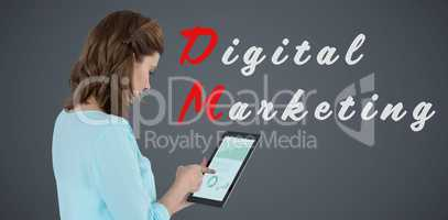 Composite image of businesswoman using tablet over white background