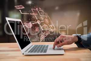 Composite image of businessman scrolling laptop mouse