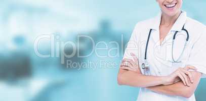Composite image of portrait of smiling female doctor standing arms crossed