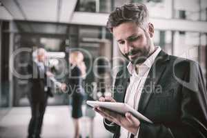 Smart businessman using digital tablet