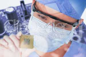 Composite image of close-up of female surgeon holding processor