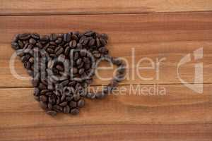 Coffee beans forming shape of cup