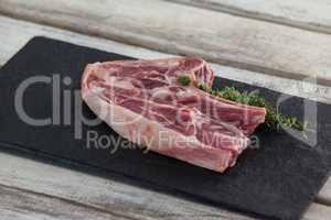 Blade chop on black slate plate