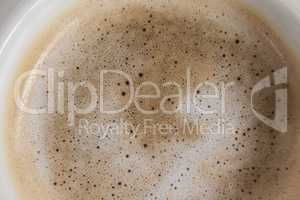 White coffee cup with creamy froth