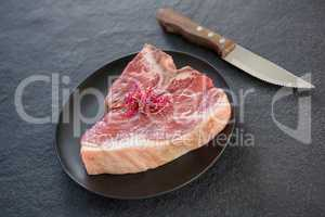 Sirloin chops garnished with shredded cabbage and knife