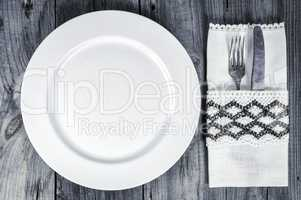 Empty white plate with cutlery