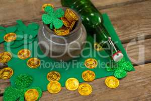 St. Patricks Day shamrock, beer bottle and pot filled with chocolate gold coins