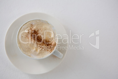 Close-up of coffee cup with creamy froth