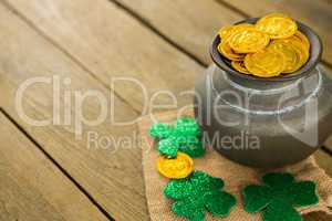St. Patricks Day shamrock and pot filled with chocolate gold coins
