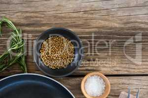 Coriander seeds, salt and rosemary herbs