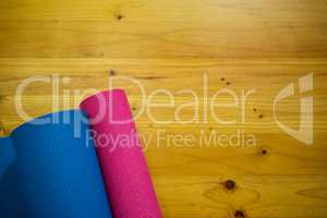 Exercise mat kept on wooden floor