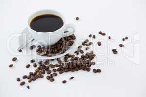 Black coffee with roasted beans