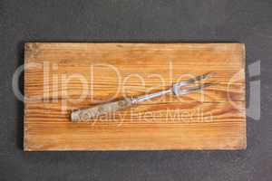 Fork on wooden board