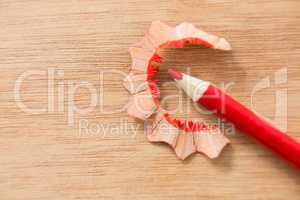 Close-up of red color pencil with pencil shaving