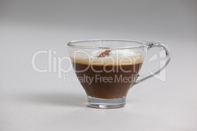 Transparent coffee cup with creamy froth