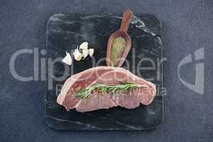 Sirloin chop, spics and garlic on slate plate