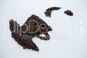 Coffee beans forming cup and saucer shape