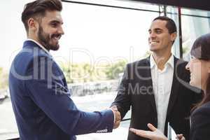 Business executives shaking hands on platform