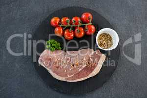 Sirloin chop, cherry tomatoes and coriander seeds