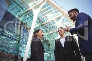 Businesses executives interacting with each other outside platform