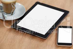 Digital table and mobile phone with cup of coffee