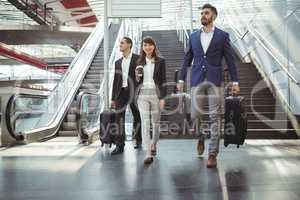 Businesses executives walking on stairs outside platform
